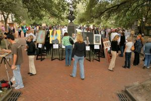student art painting in the park